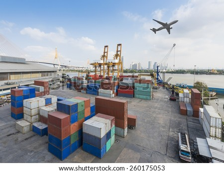 Container Cargo freight ship with working crane bridge in shipyard in Import Export Logistic Zone - stock photo