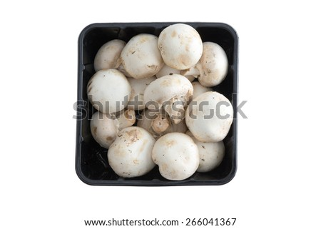 Container of farm fresh button mushrooms, or Agaraicus bisporus, one of the most popular cultivated mushrooms used in vegetarian and savory cuisine, isolated on white, overhead view - stock photo