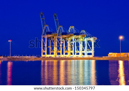 Container port terminal with cranes at sunset, sunrise, dawn time in Vancouver, Canada . Vertical. - stock photo