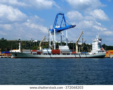 Container Ship alongside loading containers at container terminal. - stock photo
