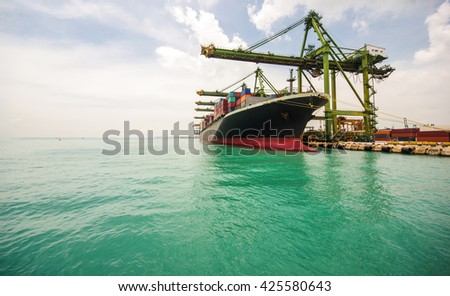 container ship berthing for import and export container box in port, copy space on left side. - stock photo