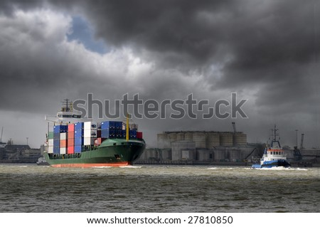 Container ship in bad weather - stock photo