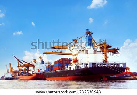 container ship in port cargo dock with piers crane tool use for import export industry and freight cargo ,logistic trading shipping service business theme - stock photo