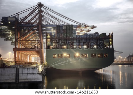Container ship in the harbor of Hamburg - stock photo