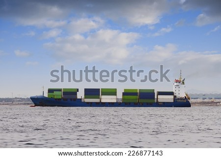 Container ship sailing after leave the harbor of Alicante - stock photo