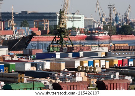 Container terminal at sea trading port - stock photo