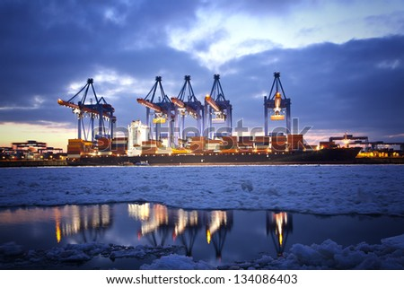 Container Terminal in Hamburg, Germany. - stock photo