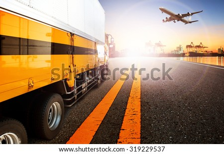container truck in shipping port and cargo plane flying for logistic and transport business - stock photo