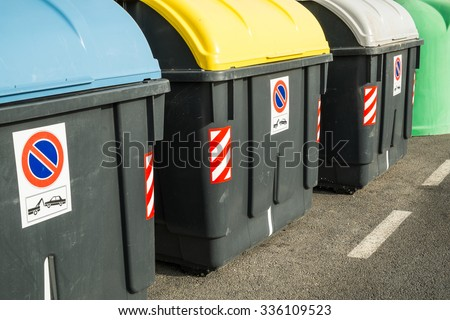 Containers in different colors to collect recyclable waste - stock photo