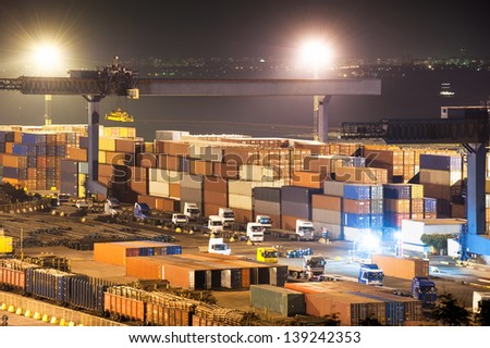 Containers in port at night - stock photo