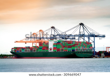 Containers loading by crane in the morning , Trade Port , Shipping , transport - stock photo