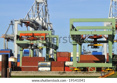 Containers with container cranes - stock photo