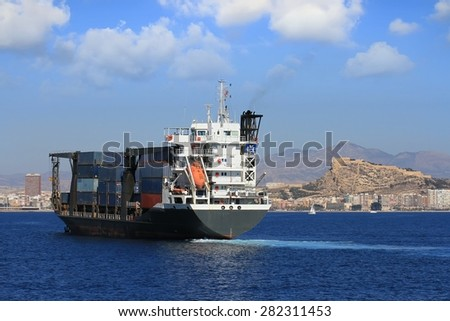 Containership finding anchorage in Alicante bay - stock photo