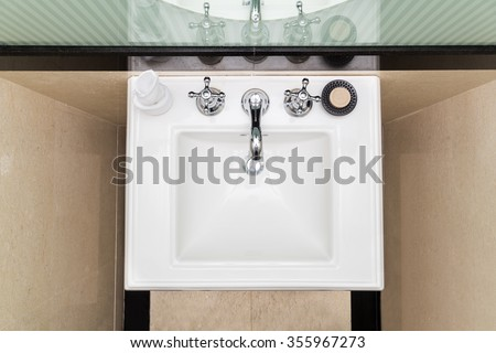 Contemporary and elegant wash basin sink in toilet bathroom - stock photo