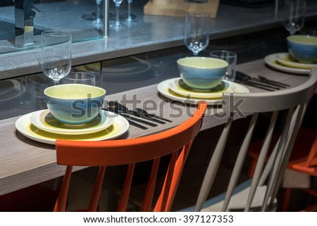 Contemporary and Stylish Kitchen Breakfast Bar with Crockery and Utensils - stock photo