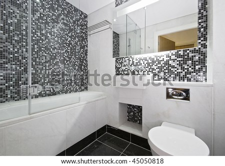 contemporary bathroom with marble and mosaic tiles - stock photo