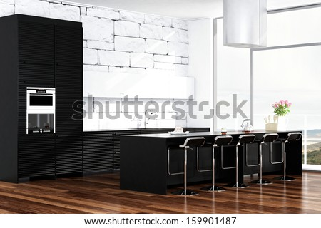 Contemporary black design kitchen in front of white stone wall - stock photo