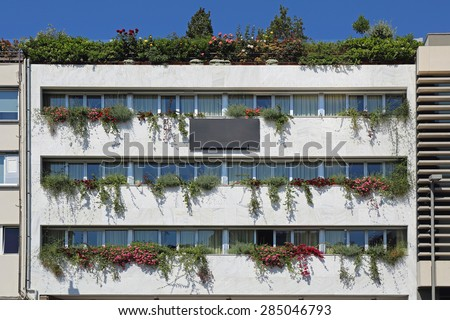 Contemporary Building with Vertical Gardens and Rooftop Terrace - stock photo