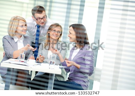 Contemporary business people working in team in the office - stock photo