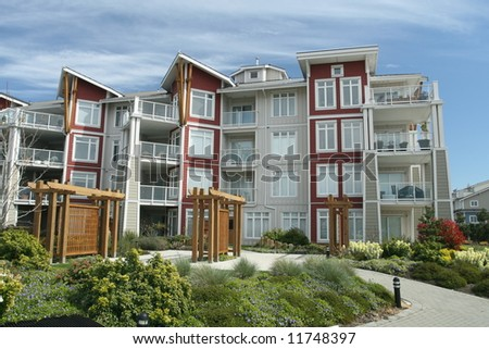 Contemporary Condominium Building in Suburban Setting - stock photo