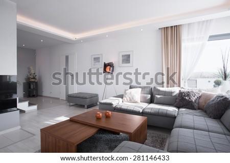 Contemporary design of spacious living room with big sofa - stock photo