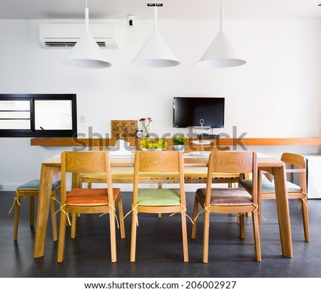 Contemporary dinning room with wooden tables and chars - stock photo