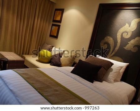 Contemporary Hotel Bedroom - stock photo