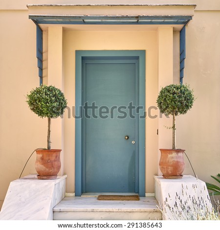 contemporary house green door and flowerpots, Athens Greece - stock photo