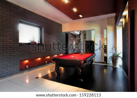 Contemporary interior, living room with a snooker table - stock photo