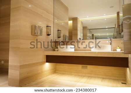 contemporary interior of public toilet - stock photo
