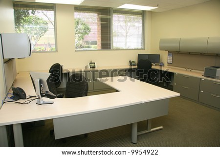 Contemporary interior office with modern furniture and technology - stock photo
