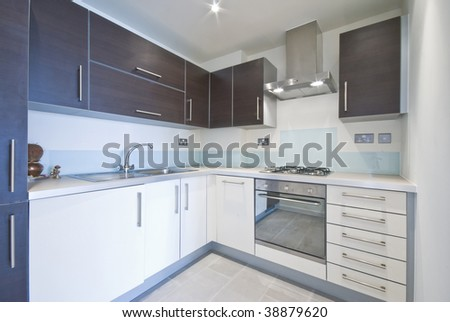 contemporary kitchen with modern electric appliances - stock photo
