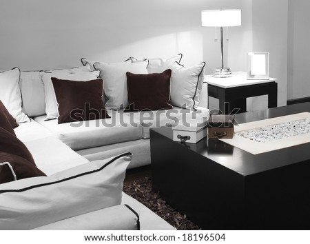 Contemporary living room decorated in white and brown - stock photo