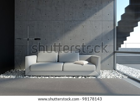 contemporary living room with concrete wall and pebble onthe floor - stock photo