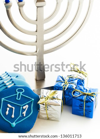 Contemporary menorah with blue candels on white background. - stock photo