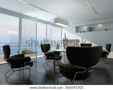 Contemporary office conference room interior with scattered armchairs around a central table in front of a glass wall overlooking the ocean and an esasel on a stand in the corner - stock photo