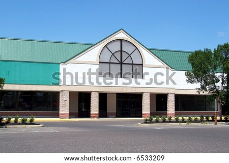 Contemporary retail storefront with view of parking lot. - stock photo