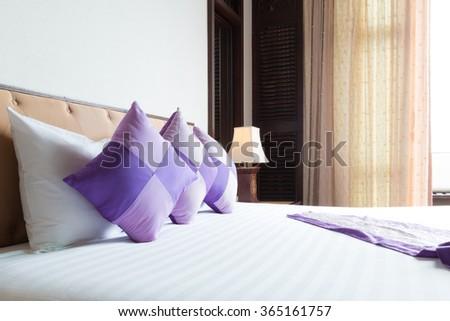 contemporary thai style hotel bedroom. - stock photo