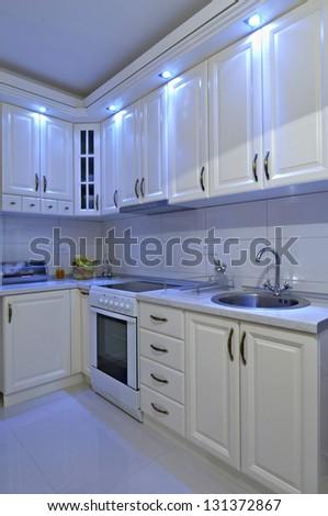 contemporary white kitchen interior - stock photo
