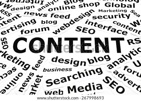 Content and other related words printed on pieces of paper. - stock photo