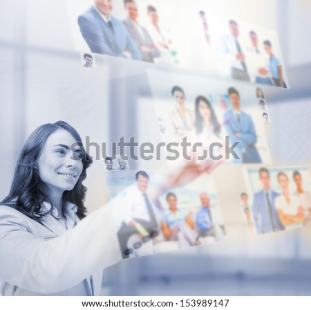 Content businesswoman selecting pictures on digital screen - stock photo