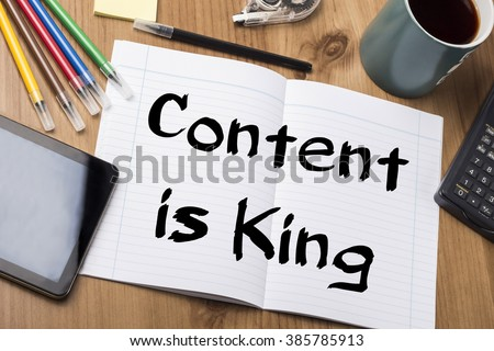 Content is King - Note Pad With Text On Wooden Table - with office  tools - stock photo
