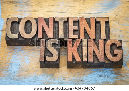 Content is king - writing and publishing wisdom - text  in vintage letterpress wood type printing blocks - stock photo
