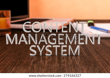 Content Management System - letters on wooden desk with laptop computer and a notebook. 3d render illustration. - stock photo