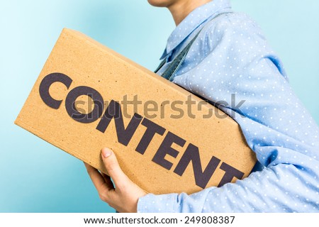 "Content marketing distribution concept. Woman carrying a box with the word ""content"" in front. - stock photo"