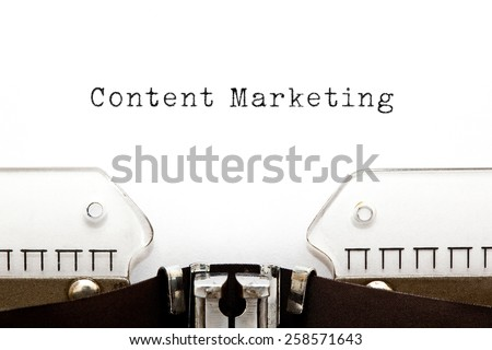 Content Marketing typed on white paper on old typewriter. - stock photo