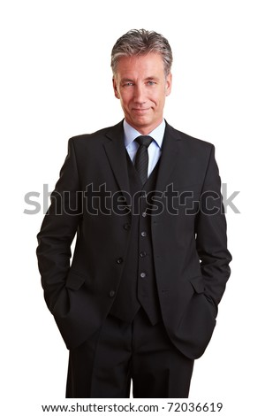 Content senior business man smiling in a suit - stock photo