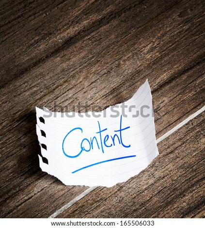 Content written on the paper on a wood background - stock photo