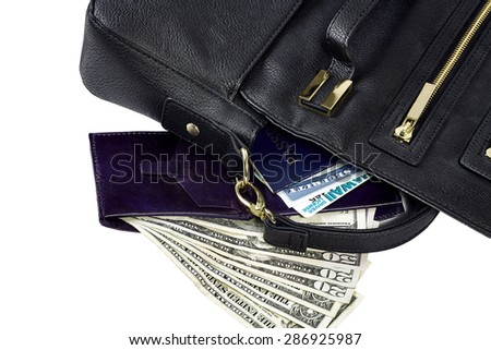 Contents of purse spilled revealing passport, social security card, drivers license, wallet, US currency isolated on white - stock photo