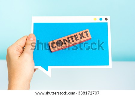 """Context. People showing the word """"context"""" on blue speech bubble concept. - stock photo"""